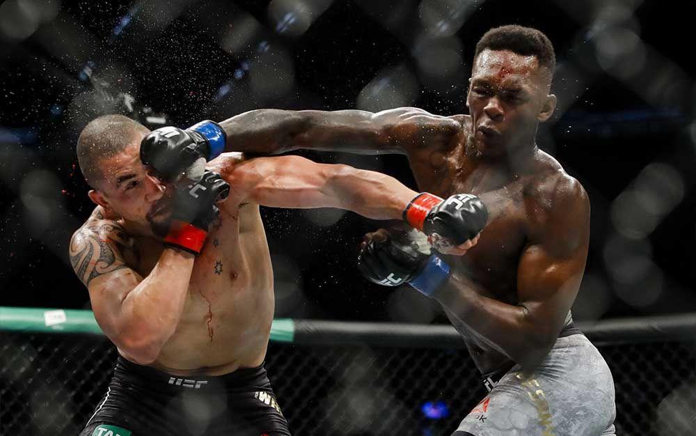 Israel Adesanya vs. Robert Whittaker v bitvě o titul střední váhy